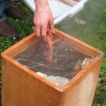 boiling water and cooking in a cedar box